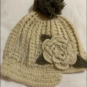 Two beautiful hand made beanies in neutral colours
